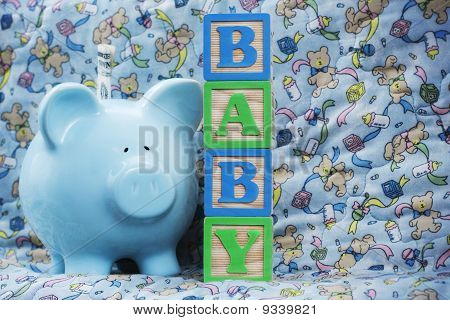 Baby With Blue Piggy Bank