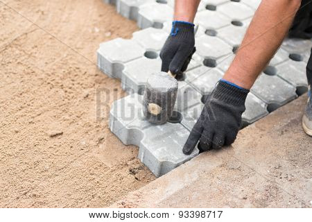 Worker Building Concrete Bricked Floor