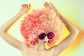 foto of provocative  - Portrait of Fashion girl in fashionable sunglasses with trendy afro hairstyle - JPG