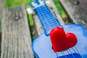 foto of heart sounds  - Red of heart on a lonely guitar - JPG