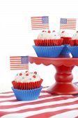 stock photo of united we stand  - Happy Fourth of July Cupcakes on red stand with USA flags on white wood shabby chice table - JPG