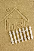 picture of mud-hut  - Abstract drawing of a house on the sand with a decorative fence - JPG