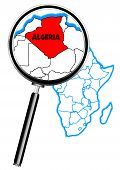 stock photo of algeria  - Algeria outline inset into a map of Africa over a white background viewed through a magnifying glass - JPG