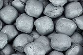 stock photo of briquette  - Charcoal Briquettes For BBQ Grill Background Texture Close - JPG