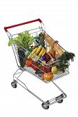 stock photo of trolley  - Filled with food shopping trolley isolated on white background no body no people the path selection is saved - JPG