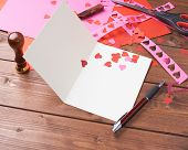 stock photo of card-making  - Making valentine card and confetti composition over the wooden surface as a copyspace card template - JPG
