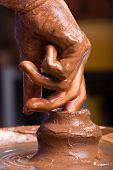 foto of pottery  - hands working on pottery wheel - JPG