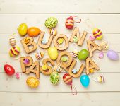 picture of pasqua  - Words Buona Pasqua as Happy Easter in italian language made of wooden letters and surrounded with multiple egg decorations as a festive Easter background composition - JPG