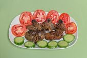 picture of liver  - grilled chicken liver with tomato and cucumber on the white dish - JPG