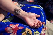 stock photo of mehendi  - black henna tattoo mehendy on hand mandala - JPG