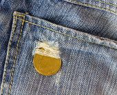 foto of copper coins  - Single coin on jean background for decorate project - JPG