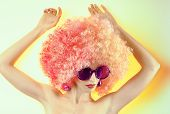 image of provocative  - Portrait of Fashion nude girl in fashionable sunglasses with trendy afro hairstyle - JPG
