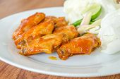 image of bbq food  - BBQ Chicken Wings on white dish (International foods) ** Note: Shallow depth of field - JPG
