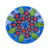 picture of mulberry  - Colorful striped spiral of raspberry and mulberry on blue plate studio isolated on white - JPG