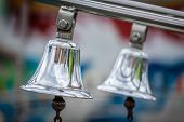 picture of funfair  - Two silver bells on a train on a funfair - JPG