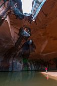 stock photo of colorado high country  - Hiker in Golden Cathedral Neon Canyon Escalante National Park Utah - JPG