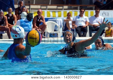 Budapest, Hungary - Jul 16, 2014. France's VALVERDE Clementine (FRA, 4) defending against Tania DI MARIO (ITA, 7). The Waterpolo European Championship was held in Alfred Hajos Swimming Centre in 2014.
