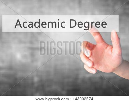 Academic Degree - Hand Pressing A Button On Blurred Background Concept On Visual Screen.