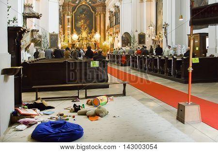 VIENNA, AUSTRIA - JUN 10, 2016: Interior of church with area for children games with toys on June 10, 2016. Vienna has population near 1.8 million
