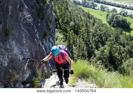 woman is climbing up on a rope