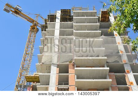 Building of the modern many-storeyed house against blue sky