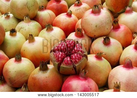 Group of pomegranate or ruby fruits, It's vitamin enriched and its edible seeds contains high dietary fiber.
