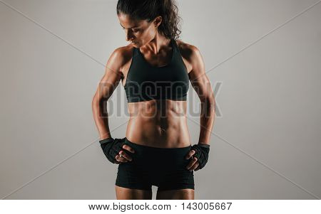 Strong Fit Young Woman Showing Off Her Abs