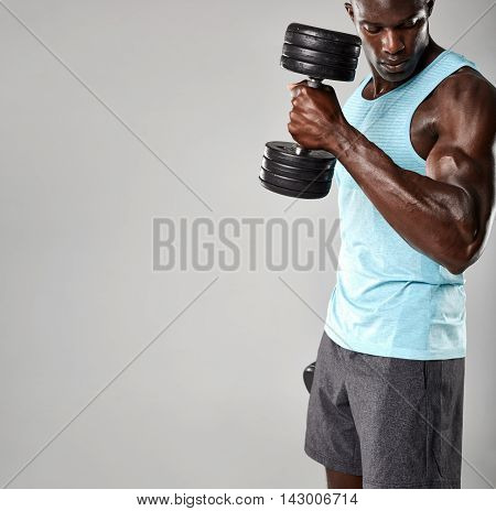 Young African Man Working Out With Dumbbells