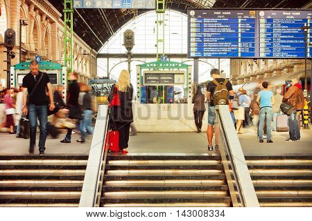 BUDAPEST, HUNGARY - MAY 29, 2016: Crowd of people on stairs of Keleti railway station waiting for the train departure on 29 May, 2016. The main international railway terminal in Budapest was constructed in 1884