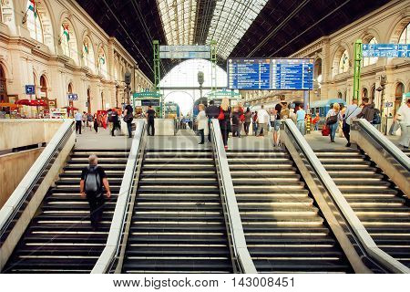 BUDAPEST, HUNGARY - MAY 29, 2016: Big hall of Keleti railway station and many people waiting for the train arrival 29 May, 2016. The main international railway terminal in Budapest was constructed in 1884