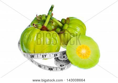 Garcinia cambogia fresh fruit with measuring tape isolated on white background. Garcinia atroviridis is spice plants. It helps in the metabolism contain high vitamin C and hydroxy citric acids (HCA)