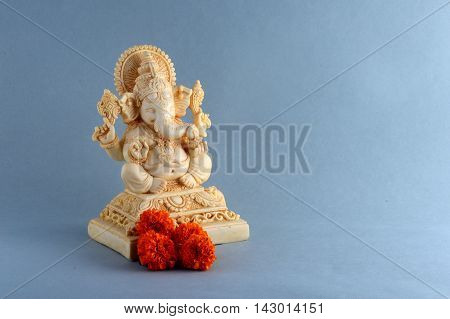 Hindu God Ganesha. Ganesha Idol on grey background