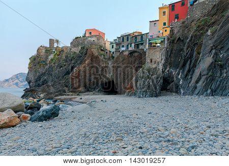 Municipal pebble beach in the old village of Vernazza. Parco Nazionale delle Cinque Terre, Liguria, Italy.