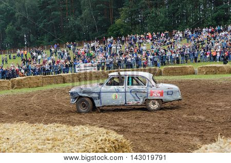 GRODNO BELARUS - AUG 13: The winner of the battle celebrate the victory on Car fighting for survival on August 13 2016 in Grodno Belarus