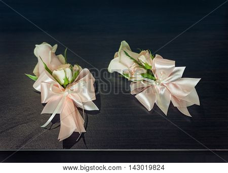 boutonniere with white rose for groomsmen