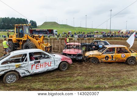 GRODNO BELARUS - AUG 13: The forklift evacuates the stuck vehicle from arena fights for survival on August 13 2016 in Grodno Belarus