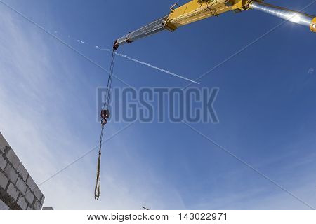 Block and tackle ball and hook on industrial crane