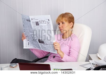 Beautiful Young Girl Reads Newspaper