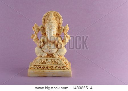 Hindu God Ganesha. Ganesha Idol on purple Background