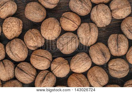 Walnuts. Walnuts an market. Background of walnuts. Healthy walnuts. Fresh walnuts