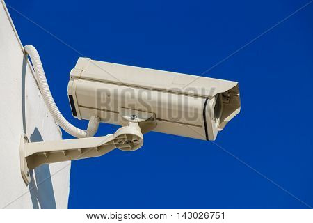 CCTV on building with blue - sky background
