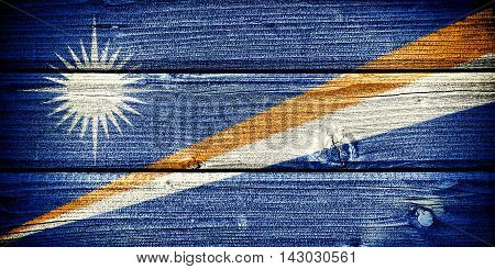 flag of the Marshall Islands painted on old grungy wooden background: 3d illustration