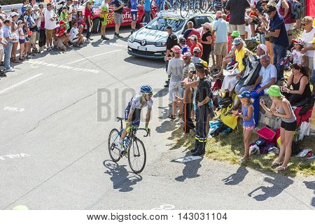 Col du Glandon France - July 23 2015: The British cyclist Simon Yates of Orica-GreenEDGE Team riding in a beautiful curve at Col du Glandon in Alps during the stage 18 of Le Tour de France 2015.