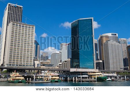 SYDNEY, AUSTRALIA - APRIL, 2016 : Sirius, Golden Grove and Queenscliff ferry docking in front of Circular Quay Railway station surrounded by tall hotel buildings in Sydney, Australia on April 20, 2016