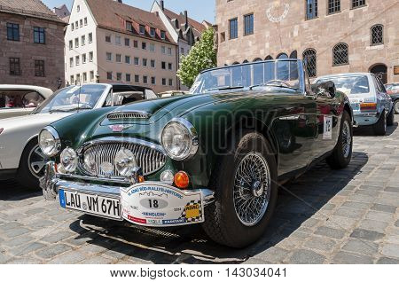 Nurnberg Bavaria / Germany - July 19th 2014: green Austin-Healey 3000 MK II sport vintage car at Sud - Rallye- Historic event in Nurnberg