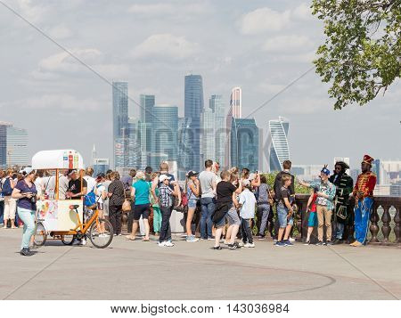 Moscow - August 11 2016: View from the observation deck on the Sparrow Hills to unusual skyscrapers of Moscow City and a lot of tourists August 11 2016 Moscow Russia