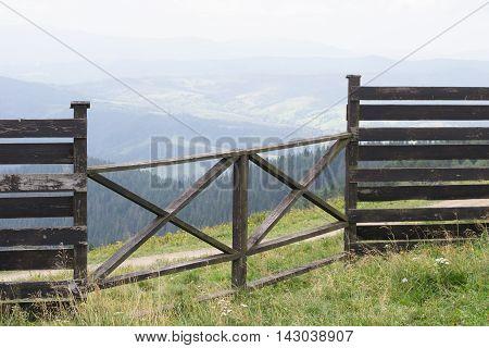 Ranch fence overlooking Carpathian Mountains in Ukraine