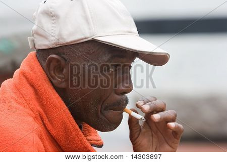 Elderly African American Man Smoking