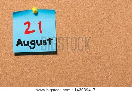 August 21st. Day 21 of month, color sticker calendar on notice board. Summer time. Empty space for text.