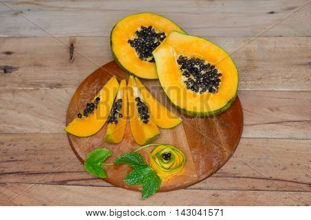 Ripe sweet papaya on wood background. Papaya